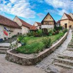 Rasnov Fortress with beautiful medieval stone houses on the main street, Brasov county, Romania. Panoramic view